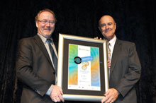 JHC Redevelopment Manager Jim Lynton receives the award from Keiran McNamara, Director General of the WA Department of Environment.